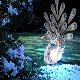 Koperkleurige Solar Tuinlamp Pauw Staandmodel. _