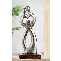 Metalen sculptuur Met hart en ziel beeld